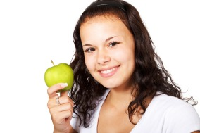 Teen with an apple